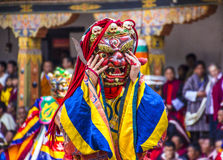 Masked dancer. S at  drupchen festival in the dzong of Punakha, Bhutan. Drupchen festival is taking place yearly in march. (Persons not recognizable Royalty Free Stock Images