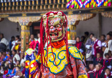 Masked dancer. S at  drupchen festival in the dzong of Punakha, Bhutan. Drupchen festival is taking place yearly in march. (unrecognizable persons Stock Image