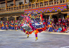 Masked dancer. S at  drupchen festival in the dzong of Punakha, Bhutan. Drupchen festival is taking place yearly in march Stock Photography