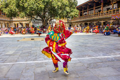 Masked dancer. S at  drupchen festival in the dzong of Punakha, Bhutan. Drupchen festival is taking place yearly in march. (Unrecognizable persons Royalty Free Stock Image