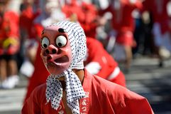 Masked dancer in a Japanese festival. A performer wearing a fool mask performing the fool dance, a dance that has steps choreographed to be very funny stock photos