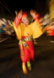 Masked dancer at a night festival in Japan. Masked dancer dressed in colorful costumes at a night festival in Japan royalty free stock images