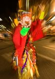 Masked dancer at a night festival in Japan. Masked dancer dressed in colorful costumes at a night festival in Japan stock image