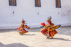 Masked dancers. At  drupchen festival in the dzong of Punakha, Bhutan. Drupchen festival is taking place yearly in march Stock Photography