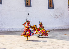 Masked dancers. At  drupchen festival in the dzong of Punakha, Bhutan. Drupchen festival is taking place yearly in march Stock Images