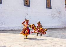 Masked dancers Stock Images
