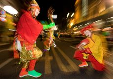 Masked dancers at a night festival in Japan. Masked dancers dressed in colorful costumes at a night festival in Japan royalty free stock photo