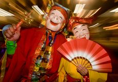 Masked dancers at a night festival in Japan. Masked dancers dressed in colorful costumes at a night festival in Japan stock image