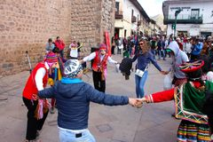 Masked dancers at Plaza  de Armas. Royalty Free Stock Photography