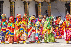 Masked dancers in a row. Masked dancers at  drupchen festival standing in a row in the dzong of Punakha, Bhutan. Drupchen festival is taking place yearly in Stock Images