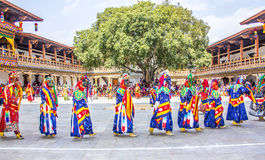 Masked dancers in a row Stock Photos