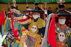 Masked dancers in traditional Ladakhi Costume performing during the annual Hemis festival stock photo