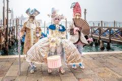 Masked elegant trio Royalty Free Stock Photography