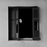 Masked figure by broken window Stock Photography