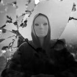 Masked figure broken mirror stock photo
