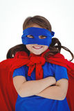Masked girl with arms crossed pretending to be superhero Royalty Free Stock Photos