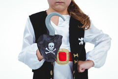 Masked girl pretending to be pirate. Masked girl showing hook pretending to be pirate Stock Photo