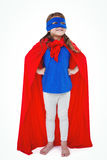 Masked girl pretending to be superhero. Looking up on white screen Stock Photo