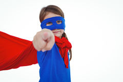 Masked girl pretending to be superhero. Pointing the camera on white screen Royalty Free Stock Photography