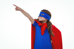 Masked girl pretending to be superhero. Masked girl pointing somewhere on white screen pretending to be superhero Stock Images