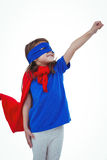 Masked girl pretending to be superhero Stock Images