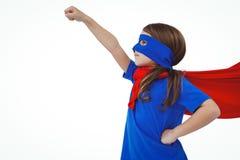 Masked girl pretending to be superhero. Raising fist on white screen Royalty Free Stock Photos