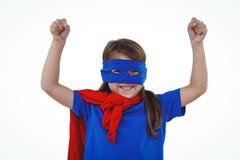 Masked girl pretending to be superhero. Raising fists on white screen Stock Photos