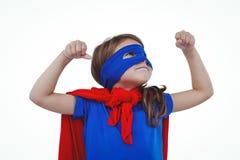 Masked girl pretending to be superhero. Raising fists on white screen Stock Image
