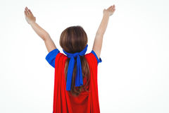 Masked girl pretending to be superhero. Rear view of masked girl pretending to be superhero on white screen Royalty Free Stock Images