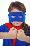 Masked girl pretending to be superhero Stock Photo