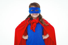Masked girl pretending to be superhero. Masked girl smiling at the camera on white screen pretending to be superhero Stock Images