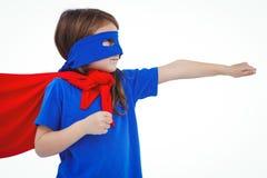 Masked girl pretending to be superhero. On white screen Royalty Free Stock Photos