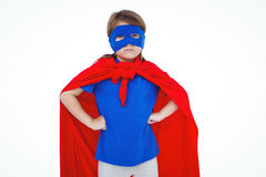 Masked girl pretending to be superhero. On white screen Royalty Free Stock Image