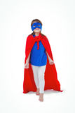 Masked girl pretending to be superhero. On white screen Royalty Free Stock Images