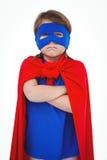 Masked girl pretending to be superhero. On white screen Royalty Free Stock Photo
