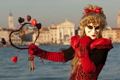 Masked girl in red costume stock photos