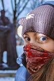 Masked girl`s shining look .
