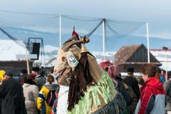 Masked goat men  on the winter ending Transylvanian traditional carnival. Crowd Royalty Free Stock Photos