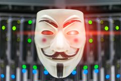 Masked Hacker in Computer Server room Concept . Masked Hacker in Computer Server room Concept Stock Photography