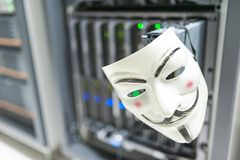 Masked Hacker in Computer Server room Concept . Royalty Free Stock Images