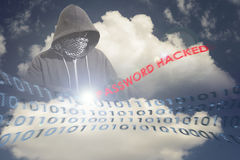 Masked Hacker in the Computing Cloud. Hacker with a hidden face breaks into a cloud computing mainframe in the sky. Copy space area for internet security and Stock Image