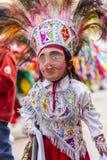 Masked kid dancer Virgen del Carmen Pisac Cuzco Peru. Pisac, Peru - July 16, 2013: masked kid dancer at Virgen del Carmen parade royalty free stock image