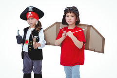 Masked kids pretending to be pirate and pilot. On white screen Royalty Free Stock Images