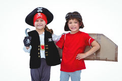 Masked kids pretending to be pirate and pilot. On white screen Royalty Free Stock Photos