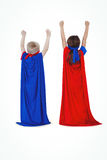 Masked kids pretending to be superheroes Stock Photography