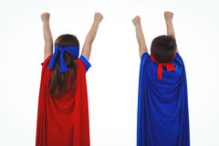 Masked kids pretending to be superheroes. Rear view of masked kids pretending to be superheroes on white screen Stock Image