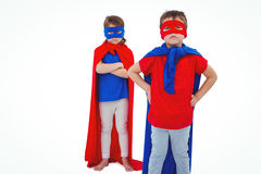 Masked kids pretending to be superheroes Stock Photos
