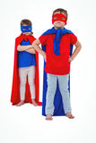 Masked kids pretending to be superheroes Stock Photo
