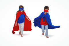 Masked kids running pretending to be superheroes Stock Photography