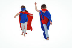 Masked kids walking pretending to be superheroes Royalty Free Stock Images